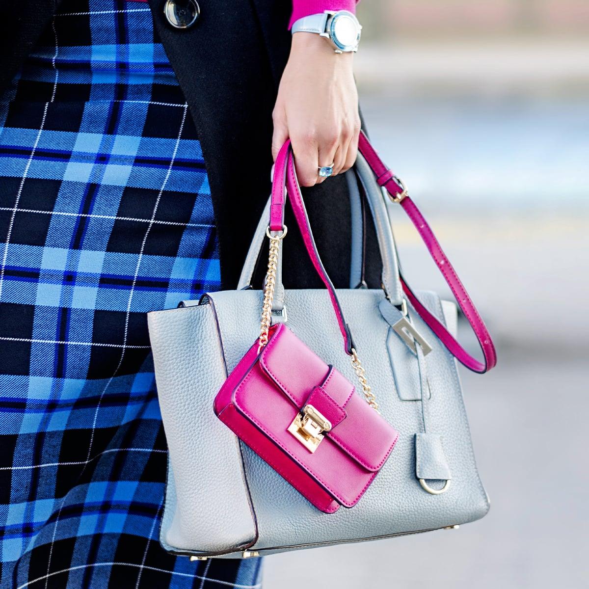 Frau mit Designerhandtasche